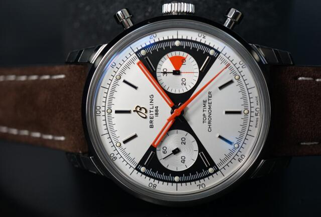 The redd hands are striking on the silver dial.